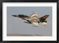 Framed F-16B Netz of the Israeli Air Force in flight over Israel
