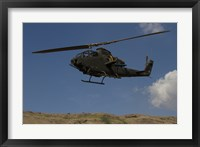 Framed AH-1F Tzefa of the Israeli Air Force flying over the Golan Heights, Israel