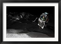 Framed Two Manned Maneuvering Vehicles explore the airless, microgravity environment of a small asteroid