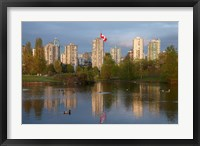 Framed Apartments reflected in Vanier Park Pond, Vancouver, British Columbia, Canada