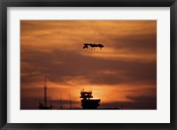 Framed MQ-1 Predator over COB Speicher at Sunset, Tikrit, Iraq