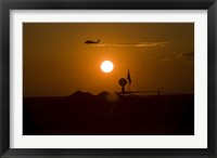Framed UH-60 Blackhawk Flies Over Camp Speicher Airfield at Sunset