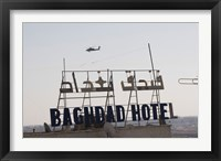 Framed AH-64 Apache in flight over the Baghdad Hotel in central Baghdad, Iraq