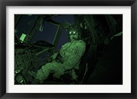Framed Pilot Wears Night vision Goggles in the Cockpit of a CH-47 Chinook Helicopter