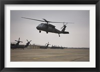 Framed UH-60 Black Hawk Taking off for a Mission Over Northern Iraq