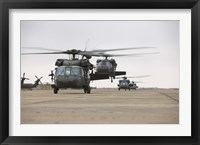 Framed UH-60 Black Hawks taxis out for a mission over northern Iraq