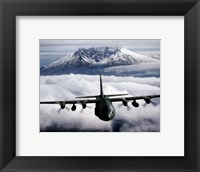 Framed C-130 Hercules aircraft flies over Mount St. Helens, Vancouver, Washington
