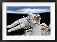 Framed Astronaut Participates in Extravehicular Activity
