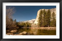 Framed El Capitan towers over Merced River, Yosemite, California