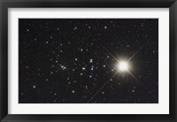 Framed Saturn in the Beehive Star Cluster