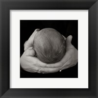 Baby In Hands II Framed Print