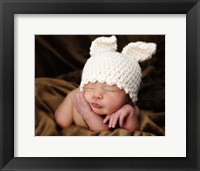 Baby In White Bunny Cap Framed Print