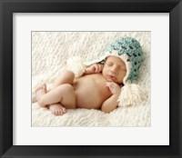 Baby In Light Blue Cap Framed Print