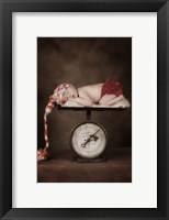 Baby In Colorful Cap Framed Print