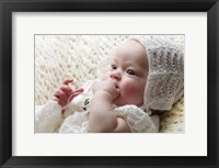 Baby In Knit Bonnet Framed Print