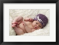 Baby In Mauve Cap Framed Print