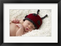 Baby In Ladybug Cap Framed Print