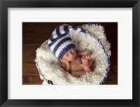 Baby In Blue And White Framed Print