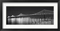 Framed Bay Bridge lit up at night, San Francisco, California