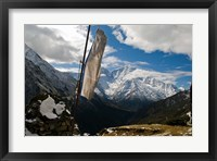 Framed Prayer flags on ridge above Dole, peak of Ama Dablam, Nepa,
