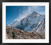 Framed Trekkers and porters on a trail, Khumbu Valley, Nepal