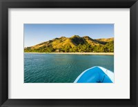 Framed Blue boat cruising through the Yasawa, Fiji, South Pacific
