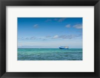 Framed Fishing boat in the turquoise waters of the blue lagoon, Yasawa, Fiji, South Pacific