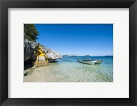 Framed Little motorboats anchoring before the Sawa-I-Lau Caves, Yasawa, Fiji, South Pacific