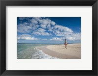 Framed Woman walking on white sand beach of Beachcomber Island, Mamanucas Islands, Fiji