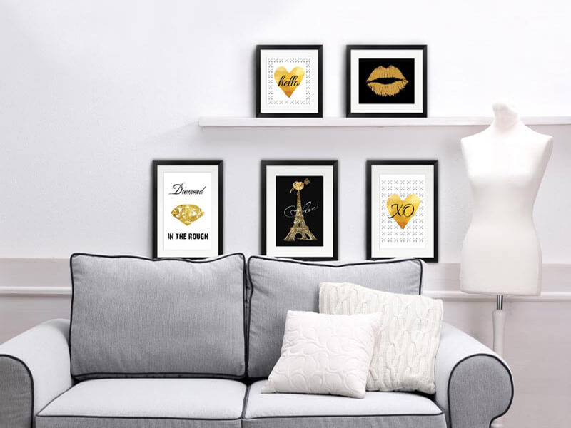 black and gold art on a shelf