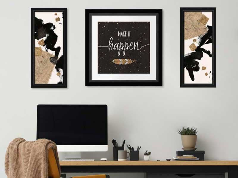framed black and gold art in an office