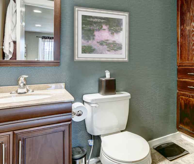 Small bathroom with art