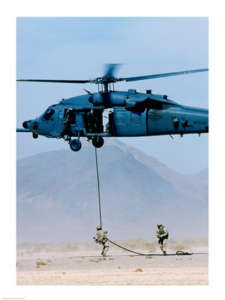 Framed Soldier rappelling from a military helicopter, Indian Springs Air Force Auxiliary Air Field, Nevada, USA Print
