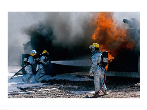 Framed Three firefighters extinguishing a fire Print