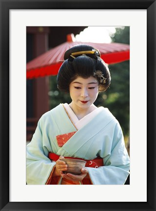 Framed Young woman dressed as a Geisha, Japan Print