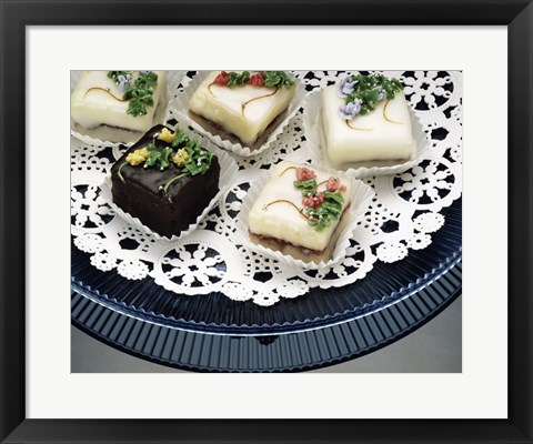 Framed Close-up of assorted cakes on a plate Print