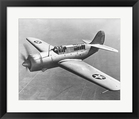 Framed High angle view of a fighter plane in flight, Curtiss SB2C Helldiver, December 1941 Print