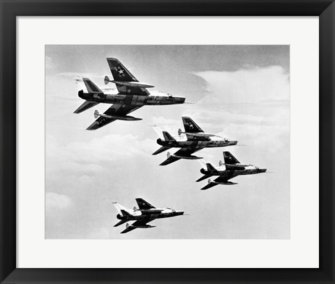 Framed Low angle view of four fighter planes flying in formation, F-100 Super Sabre Print