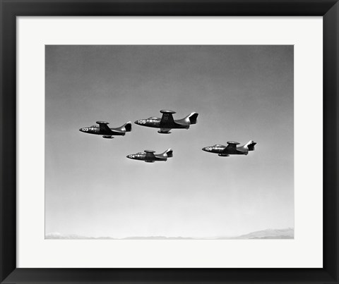 Framed Low angle view of four fighter planes flying in formation, F9F Panther Print