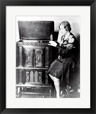 Framed Young woman sitting beside an RCA Radio-Phonograph and Home Recorder Print
