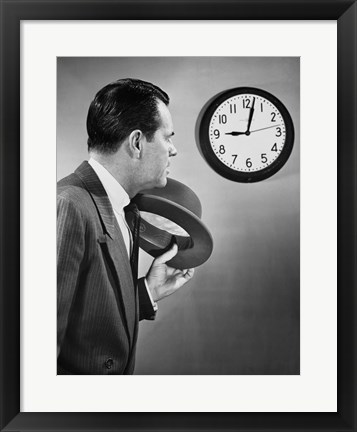 Framed Businessman looking at clock Print
