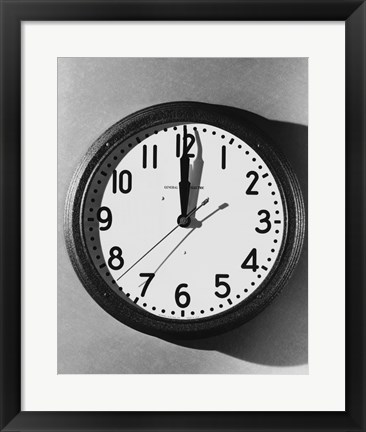 Framed Close-up of a wall clock hanging on a wall Print
