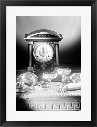 Framed Clock showing 12 o'clock with champagne flutes and party hats in the foreground Print