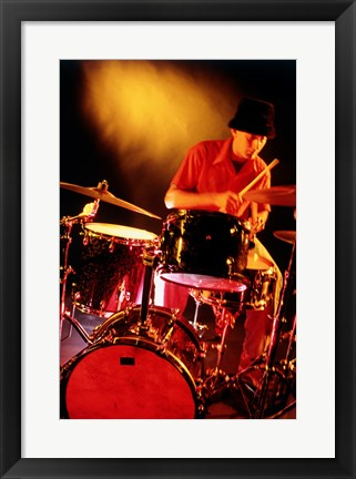 Framed Male drummer playing drums Print