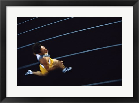 Framed High angle view of a young man running on a running track Print