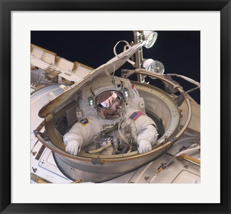 Framed Astronaut Drew Feustel Re-enters the Space Station Print