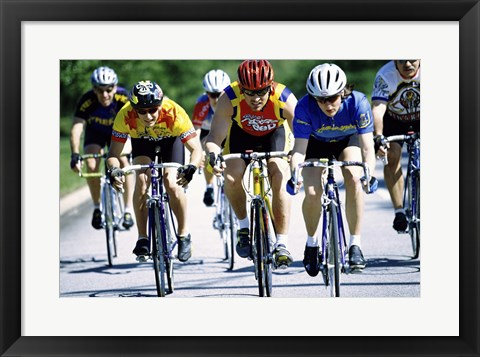 Framed Group of cyclists riding bicycles Print