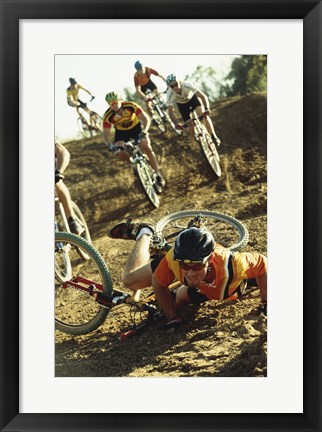 Framed Young man falling off his bicycle in a race Print