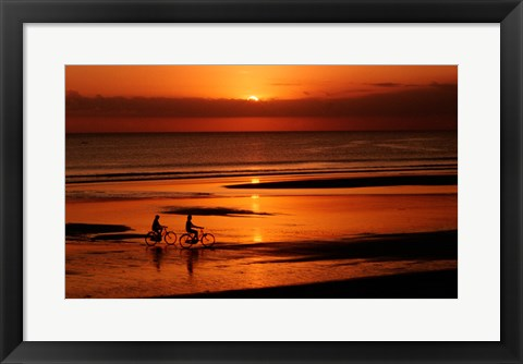 Framed Silhouette of a young couple cycling on the beach Print