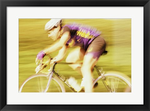 Framed Side profile of a young man cycling Print